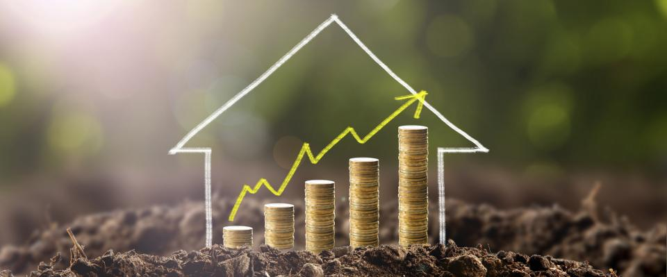 Home financing concept with progressively larger stacks of coins